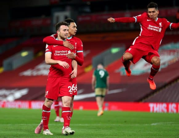 Liverpool's Diogo Jota celebrates scoring his side's second goal of the game with Trent Alexander-Arnold (second right) and Roberto Firmino (right) during the Premier League match at Anfield, Liverpool. (Image: Peter Byrne/PA Wire/PA Images)