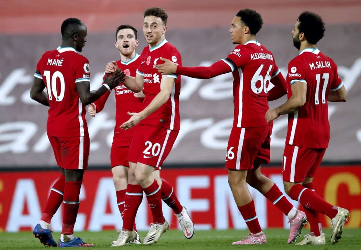 Liverpool's Diogo Jota (centre) celebrates scoring his side's second goal of the game with his teammates during the Premier League match at Anfield, Liverpool.