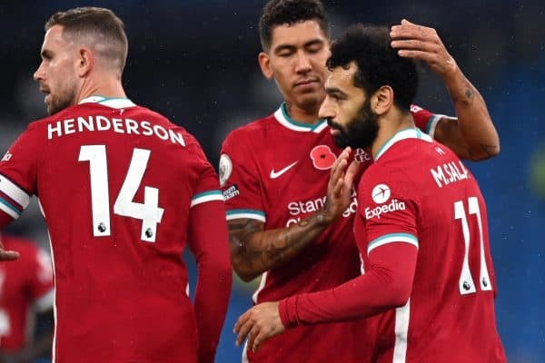 Liverpool's Mohamed Salah (right) celebrates scoring his side's first goal of the game from the penalty spot with Roberto Firmino during the Premier League match at the Etihad Stadium, Manchester.