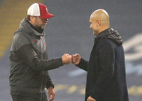 Liverpool manager Jurgen Klopp (left) and Manchester City manager Pep Guardiola after the final whistle during the Premier League match at the Etihad Stadium, Manchester. (Martin Rickett/PA Wire/PA Images)