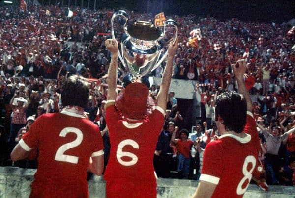 (L-R) Liverpool's Phil Neal, Emlyn Hughes and Jimmy Case show the European Cup to their jubilant fans
