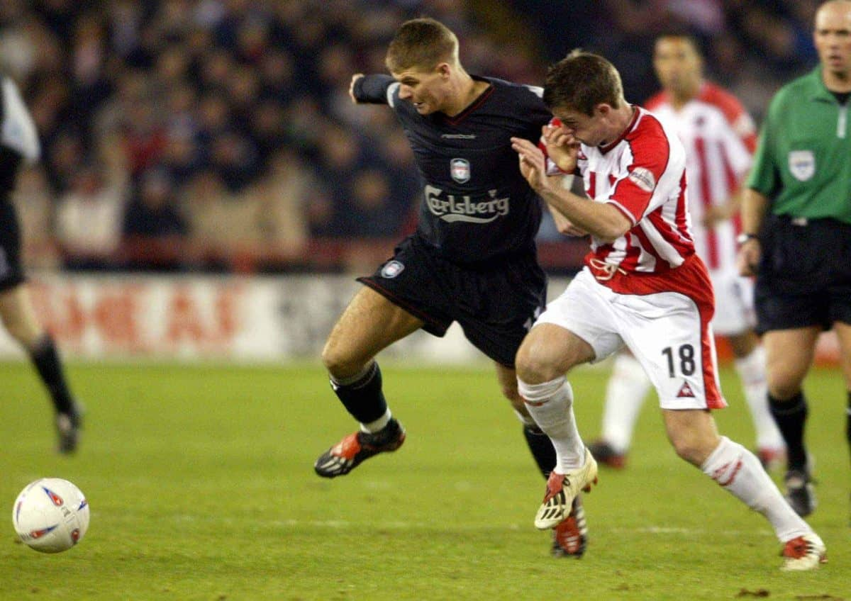 Sheffield United's Michael Tonge and Liverpool's Steven Gerrard battle for the ball