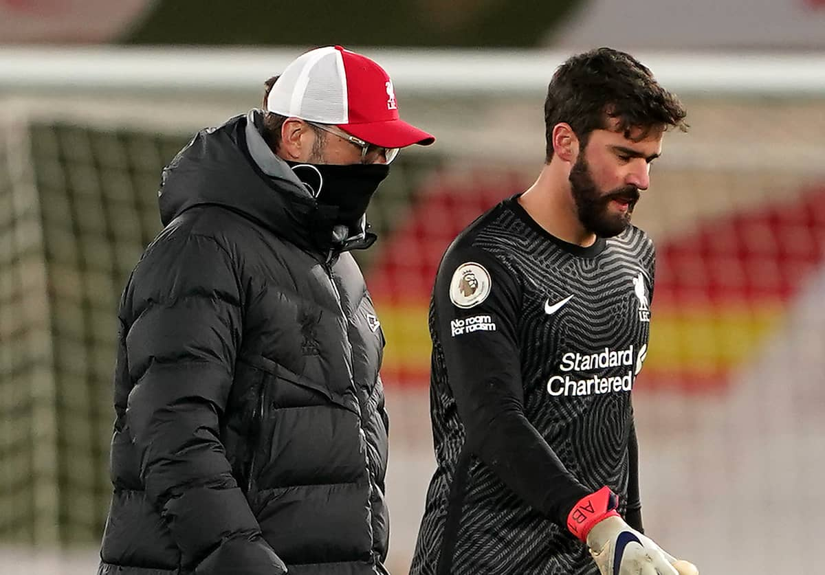 Liverpool manager Jurgen Klopp (left) and goalkeeper Alisson appears frustrated after the final whistle during the Premier League match at Anfield, Liverpool. Picture date: Thursday January 21, 2021. (Zac Goodwin/PA Wire/PA Images)