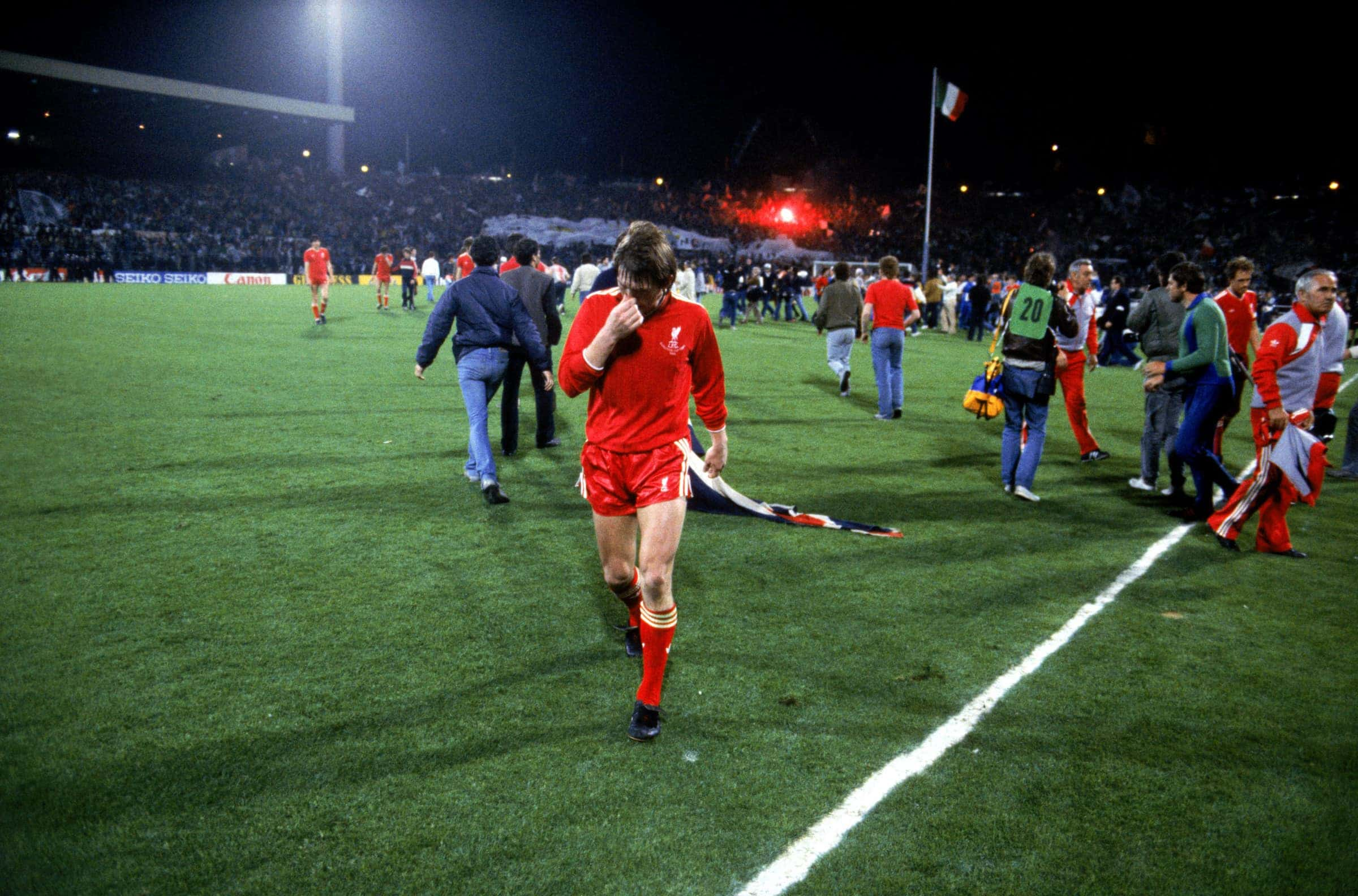 Liverpool's Kenny Dalglish walks off the pitch after his team's 1-0 defeat
