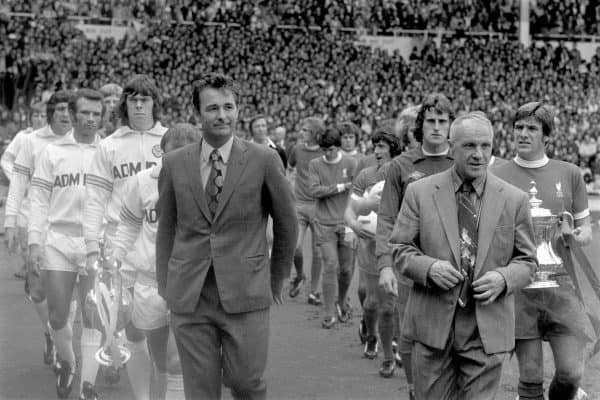 The two managers, Leeds United's Brian Clough and Liverpool's Bill Shankly, lead their teams out onto the pitch as the captains, Leeds United's Billy Bremner and Liverpool's Emlyn Hughes, carry the trophies their teams won the previous season. (l-r) Leeds United's Allan Clarke, Norman Hunter, Paul Reaney, Gordon McQueen, David Harvey, Billy Bremner, Brian Clough, Liverpool's Phil Thompson, Peter Cormack, Phil Boersma, Kevin Keegan, Alec Lindsay, Ray Clemence, Bill Shankly, Emlyn Hughes