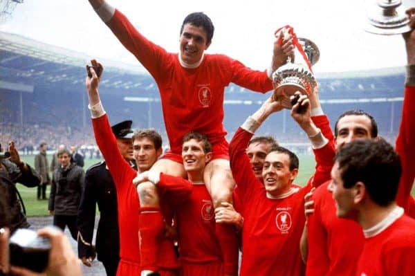 Liverpool captain Ron Yeats (top) holds onto the FA Cup as he is hoisted aloft by his jubilant teammates after their 2-1 win: (l-r) Geoff Strong, Yeats, Wilf Stevenson, Peter Thompson, Ian St John, Gerry Byrne, Ian Callaghan - PA Photos/PA Archive/PA Images