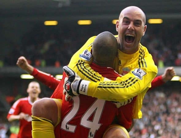 Liverpool's David Ngog (centre) celebrates scoring his sides second goal of the game with goalkeeper Jose Reina (right) (PA Image)