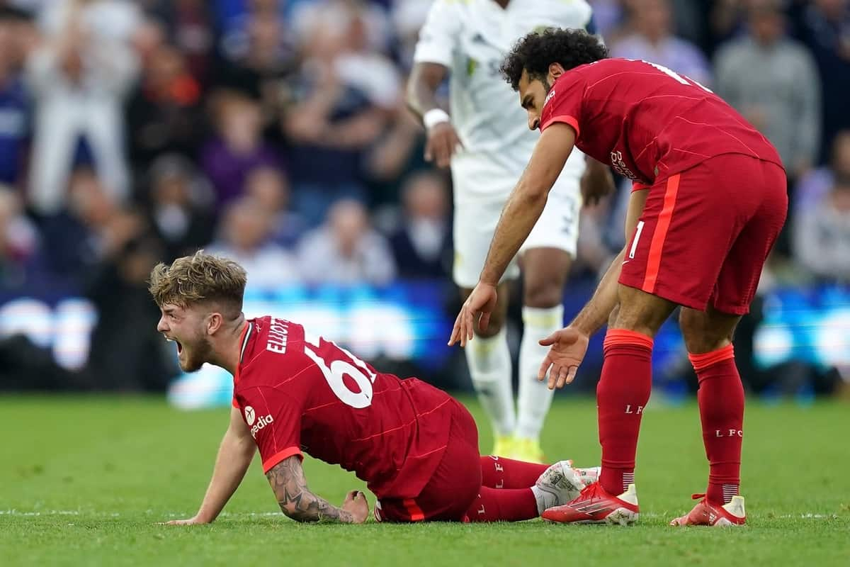 Liverpool's Harvey Elliott calls out in pain as team-mate Mohamed Salah checks on his condition after picking up a bad injury following a challenge by Leeds United's Pascal Struijk during the Premier League match at Elland Road, Leeds. Picture date: Sunday September 12, 2021.