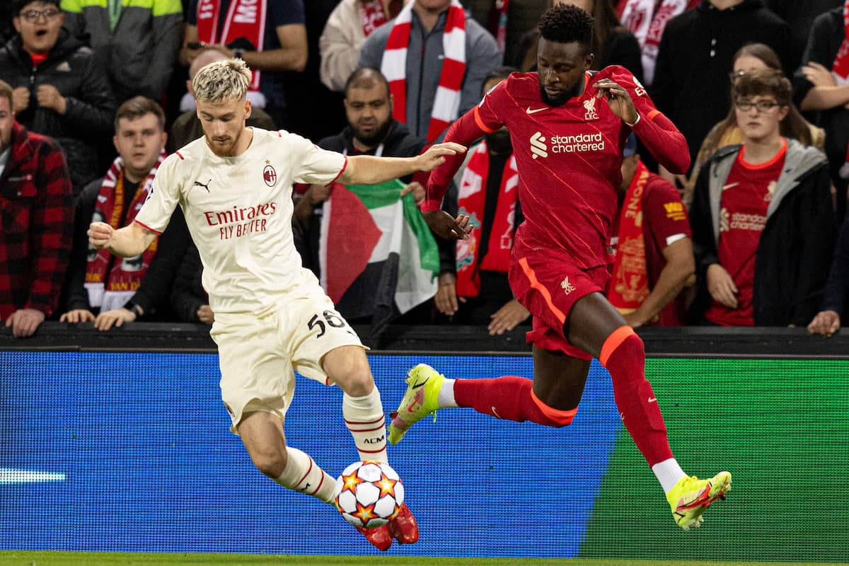 LIVERPOOL, ENGLAND - Wednesday, September 15, 2021: AC Milan's Alexis Saelemaekers and Liverpool's Divock Origi during the UEFA Champions League Group B Matchday 1 game between Liverpool FC and AC Milan at Anfield. (Pic by Paul Currie/Propaganda)