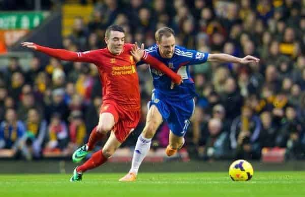 LIVERPOOL, ENGLAND - Wednesday, January 1, 2014: Liverpool's Iago Aspas in action against Hull City's David Meyler during the Premiership match at Anfield. (Pic by David Rawcliffe/Propaganda)
