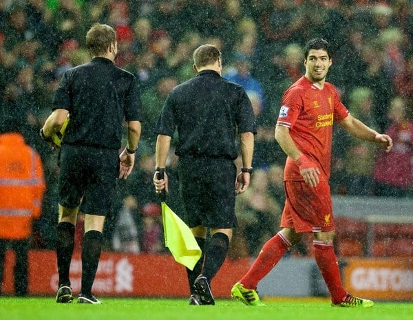 LIVERPOOL, ENGLAND - Wednesday, January 1, 2014: Liverpool's Luis Suarez talks to referee Craig Pawson after the 2-0 victory over Hull City during the Premiership match at Anfield. (Pic by David Rawcliffe/Propaganda)