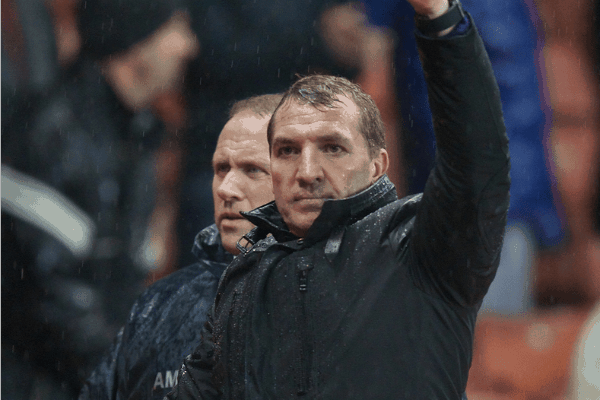 STOKE-ON-TRENT, ENGLAND - Sunday, January 12, 2014: Liverpool's manager Brendan Rodgers applauds the travelling supporters after his side's 5-3 victory over Stoke City during the Premiership match at the Britannia Stadium. (Pic by David Rawcliffe/Propaganda)