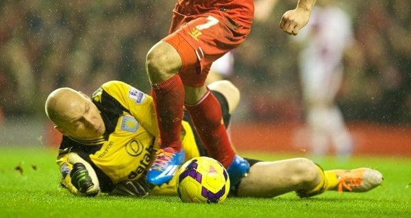 LIVERPOOL, ENGLAND - Saturday, January 18, 2014: Liverpool's Luis Suarez is brought down by Aston Villa's goalkeeper Brad Guzan for a penalty during the Premiership match at Anfield. (Pic by David Rawcliffe/Propaganda)