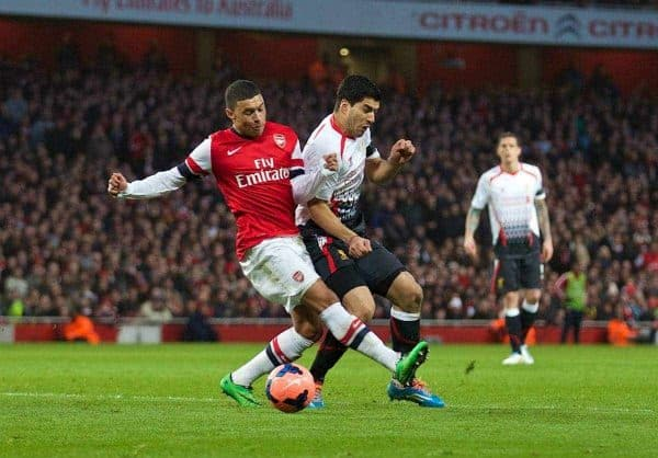 LONDON, ENGLAND - Sunday, February 16, 2014: Liverpool's Luis Suarez is hacked down by Arsenal's Alex Oxlade-Chamberlain but amazingly no penalty was given during the FA Cup 5th Round match at the Emirates Stadium. (Pic by David Rawcliffe/Propaganda)