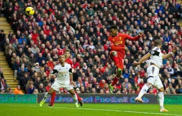 LIVERPOOL, ENGLAND - Sunday, February 23, 2014: Liverpool's Daniel Sturridge scores the third goal against Swansea City during the Premiership match at Anfield. (Pic by David Rawcliffe/Propaganda)