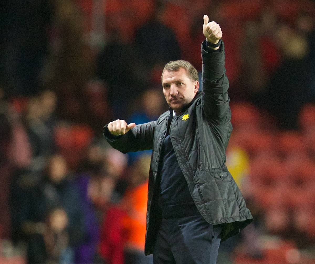 SOUTHAMPTON, ENGLAND - Saturday, March 1, 2014: Liverpool's manager Brendan Rodgers salutes the travelling supporters as his side beat Southampton 3-0 during the Premiership match at St Mary's Stadium. (Pic by David Rawcliffe/Propaganda)