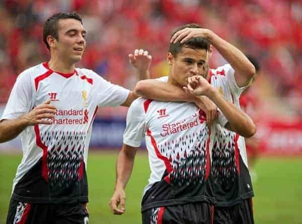 BANGKOK, THAILAND - Sunday, July 28, 2013: Liverpool's Philippe Coutinho Correia celebrates scoring the first goal against Thailand XI during a preseason friendly match at the Rajamangala National Stadium. (Pic by David Rawcliffe/Propaganda)