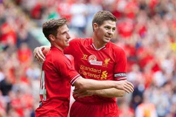 LIVERPOOL, ENGLAND - Saturday, August 3, 2013: Liverpool's Joe Allen celebrates scoring the first goal against Olympiakos CFP with team-mate captain Steven Gerrard during a preseason friendly match at Anfield. (Pic by David Rawcliffe/Propaganda)