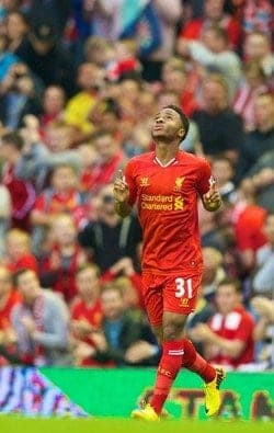 LIVERPOOL, ENGLAND - Tuesday, August 27, 2013: Liverpool's Raheem Sterling celebrates scoring the first goal against Notts County during the Football League Cup 2nd Round match at Anfield. (Pic by David Rawcliffe/Propaganda)