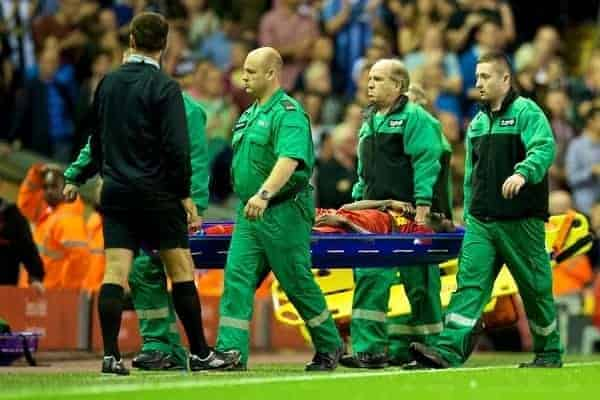 LIVERPOOL, ENGLAND - Tuesday, August 27, 2013: Liverpool's Kolo Toure is stretchered off injured during the Football League Cup 2nd Round match against Notts County at Anfield. (Pic by David Rawcliffe/Propaganda)