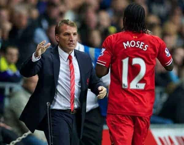 SWANSEA, WALES - Monday, September 16, 2013: Liverpool's Victor Moses celebrates scoring the second goal against Swansea City, on his debut, with manager Brendan Rodgers during the Premiership match at the Liberty Stadium. (Pic by David Rawcliffe/Propaganda)