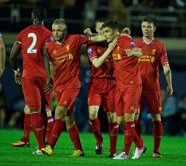 MANCHESTER, ENGLAND - Monday, September 23, 2013: Liverpool's Adam Morgan celebrates scoring the first goal against Manchester City during the Under 21 FA Premier League match at Ewen Fields. (Pic by David Rawcliffe/Propaganda)