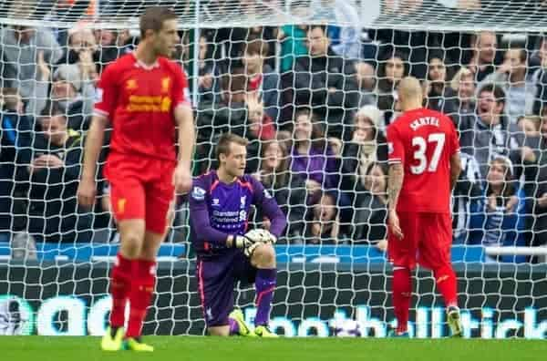 NEWCASTLE-UPON-TYNE, ENGLAND - Saturday, October 19, 2013: Liverpool's goalkeeper Simon Mignolet looks dejected as Newcastle United score the opening goal during the Premiership match at St. James' Park. (Pic by David Rawcliffe/Propaganda)