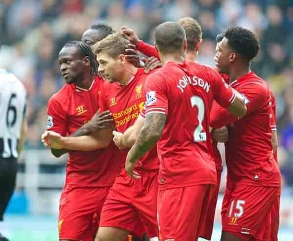 NEWCASTLE-UPON-TYNE, ENGLAND - Saturday, October 19, 2013: Liverpool's captain Steven Gerrard is mobbed by team-mates after scoring the first equalising goal against Newcastle United during the Premiership match at St. James' Park. (Pic by David Rawcliffe/Propaganda)