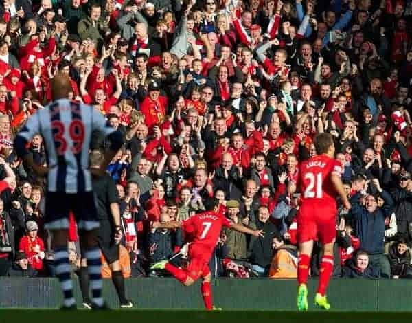 LIVERPOOL, ENGLAND - Saturday, October 26, 2013: Liverpool's Luis Suarez celebrates scoring the first goal against West Bromwich Albion during the Premiership match at Anfield. (Pic by David Rawcliffe/Propaganda)