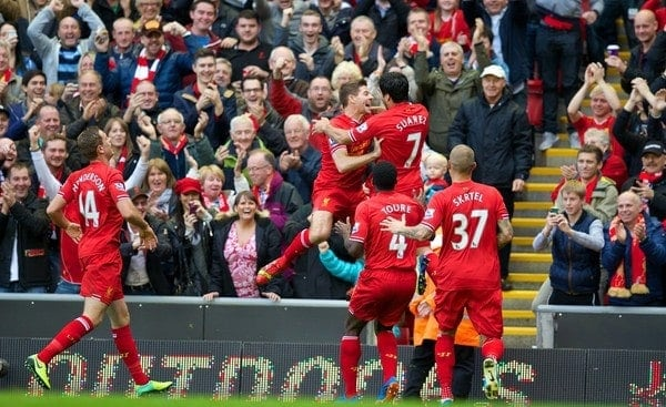 LIVERPOOL, ENGLAND - Saturday, October 26, 2013: Liverpool's hat-trick hero Luis Suarez celebrates scoring the third goal against West Bromwich Albion, to complete his hat-trick, with team-mate captain Steven Gerrard during the Premiership match at Anfield. (Pic by David Rawcliffe/Propaganda)