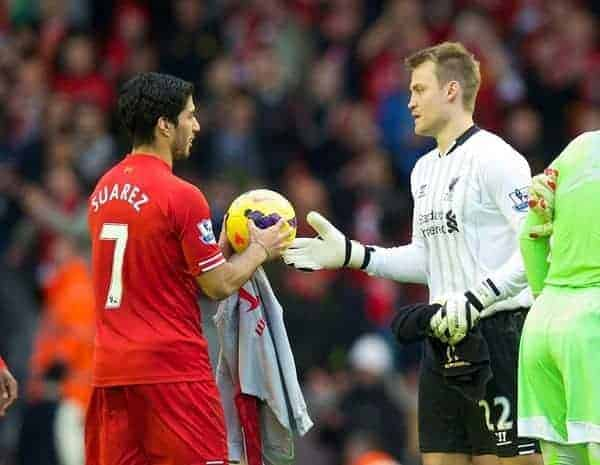 LIVERPOOL, ENGLAND - Saturday, October 26, 2013: Liverpool's hat-trick hero is handed the match-ball by goalkeeper Simon Mignolet after the 4-1 victory over West Bromwich Albion during the Premiership match at Anfield. (Pic by David Rawcliffe/Propaganda)
