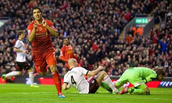 LIVERPOOL, ENGLAND - Saturday, November 9, 2013: Liverpool's Luis Suarez celebrates scoring the fourth goal against Fulham, his hat-trick third goal, during the Premiership match at Anfield. (Pic by David Rawcliffe/Propaganda)