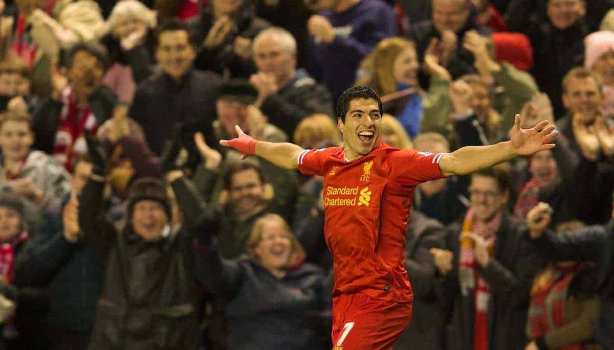 LIVERPOOL, ENGLAND - Wednesday, December 4, 2013: Liverpool's Luis Suarez celebrates scoring the first goal against Norwich City during the Premiership match at Anfield. (Pic by David Rawcliffe/Propaganda)