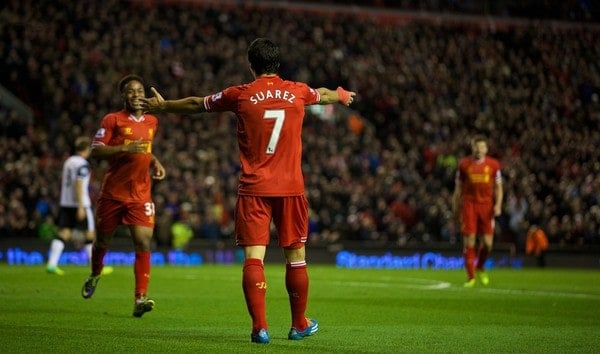 LIVERPOOL, ENGLAND - Wednesday, December 4, 2013: Liverpool's Luis Suarez celebrating Raheem Sterling's first and Liverpool's fifth goal against Norwich City during the Premiership match at Anfield. (Pic by David Rawcliffe/Propaganda)
