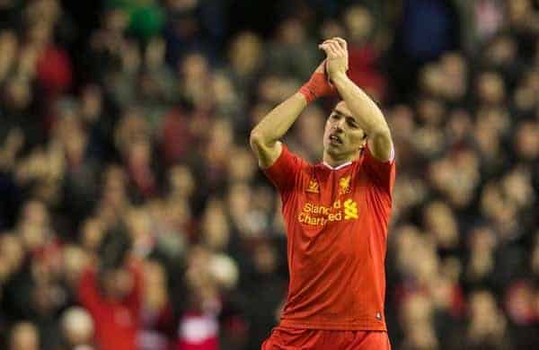 LIVERPOOL, ENGLAND - Wednesday, December 4, 2013: Liverpool's Luis Suarez gets a standing ovation from the supporters after his four goals helped seal a 5-1 victory against Norwich City during the Premiership match at Anfield. (Pic by David Rawcliffe/Propaganda)