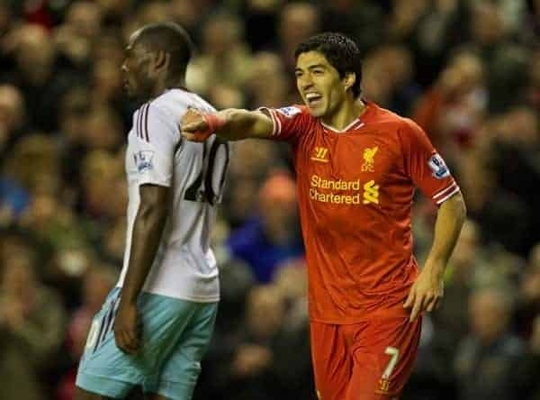 LIVERPOOL, ENGLAND - Saturday, December 7, 2013: Liverpool's Luis Suarez celebrates scoring the third goal against West Ham United during the Premiership match at Anfield. (Pic by David Rawcliffe/Propaganda)