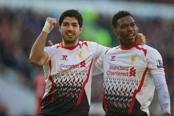 CARDIFF, WALES - Saturday, March 22, 2014: Liverpool's Daniel Sturridge celebrates scoring the fith goal against Cardiff City with team-mate Luis Suarez during the Premiership match at the Cardiff City Stadium. (Pic by David Rawcliffe/Propaganda)