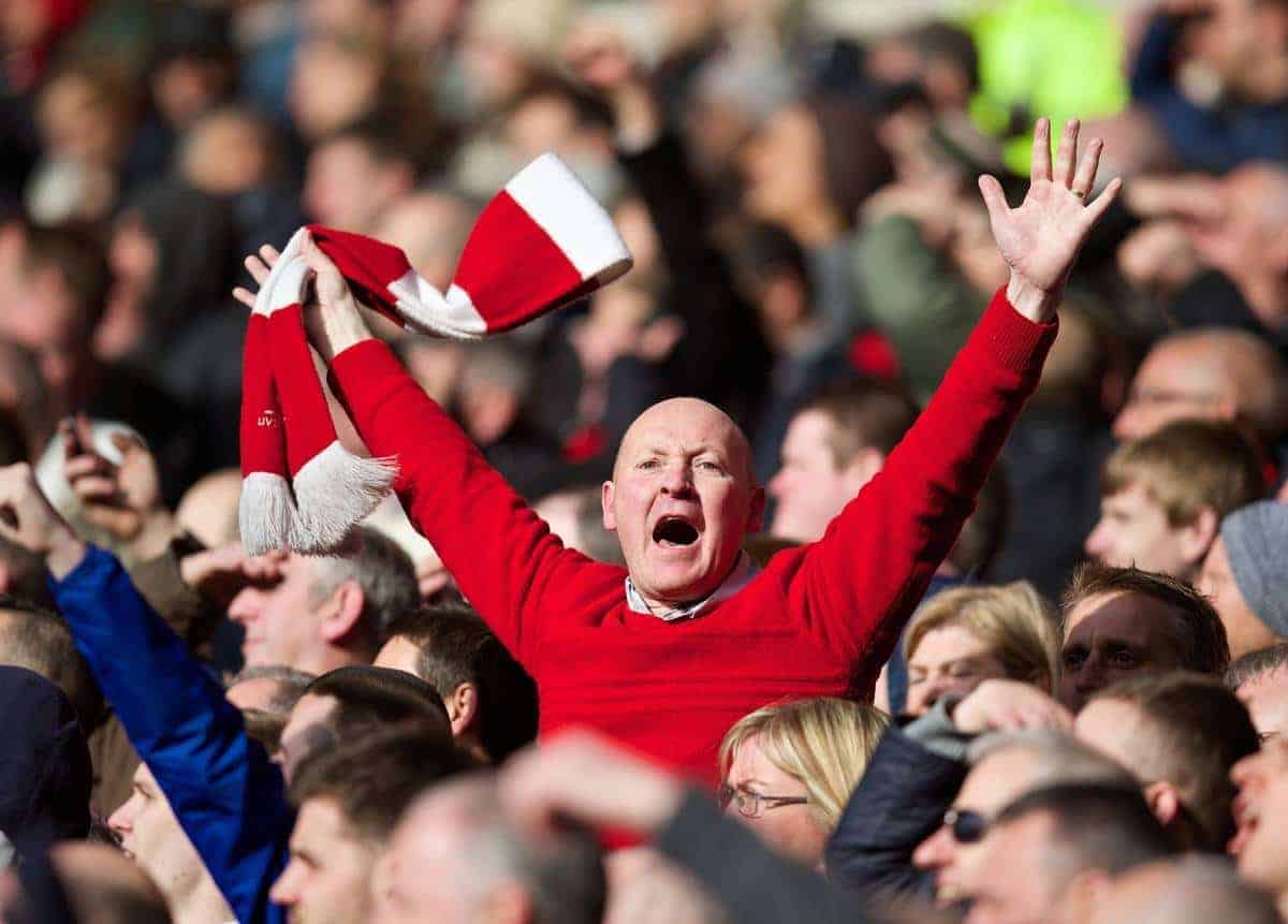CARDIFF, WALES - Saturday, March 22, 2014: A Liverpool supporter celebrates his side's 6-3 victory over Cardiff City during the Premiership match at the Cardiff City Stadium. (Pic by David Rawcliffe/Propaganda)
