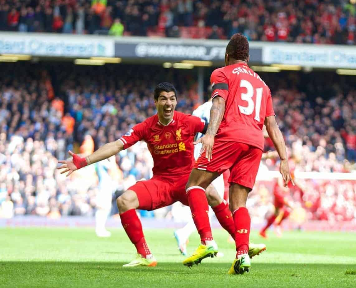 LIVERPOOL, ENGLAND - Sunday, April 13, 2014: Liverpool's Raheem Sterling celebrates scoring the first goal against Manchester City with team-mate Luis Suarez during the Premiership match at Anfield. (Pic by David Rawcliffe/Propaganda)
