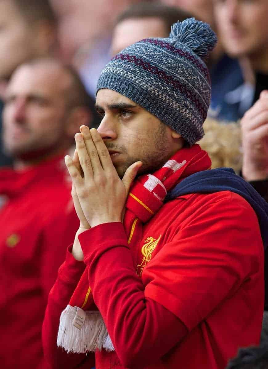LIVERPOOL, ENGLAND - Sunday, April 27, 2014: A Liverpool supporter looks dejected as his side are beaten 2-0 by an ultra defensive Chelsea team during the Premiership match at Anfield. (Pic by David Rawcliffe/Propaganda)