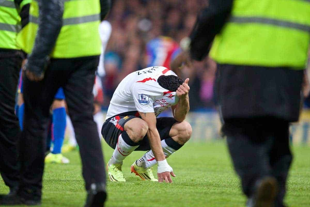 LONDON, ENGLAND - Monday, May 5, 2014: Liverpool's Luis Suarez looks dejected after he sees his side's three goal lead disappear as they draw 3-3 with Crystal Palace during the Premiership match at Selhurst Park. (Pic by David Rawcliffe/Propaganda)
