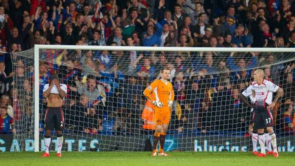 LONDON, ENGLAND - Monday, May 5, 2014: Liverpool's goalkeeper Simon Mignolet along with Glen Johnson and Martin Skrtel look dejected as Crystal Palace score the third goal during the Premiership match at Selhurst Park. (Pic by David Rawcliffe/Propaganda)
