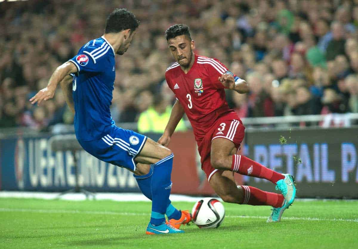CARDIFF, WALES - Friday, October 10, 2014: Wales Neil Taylor in action against Bosnia and Herzegovina during the UEFA Euro 2016 qualifying match at the Cardiff City Stadium. (Pic by Ian Cook/Propaganda)