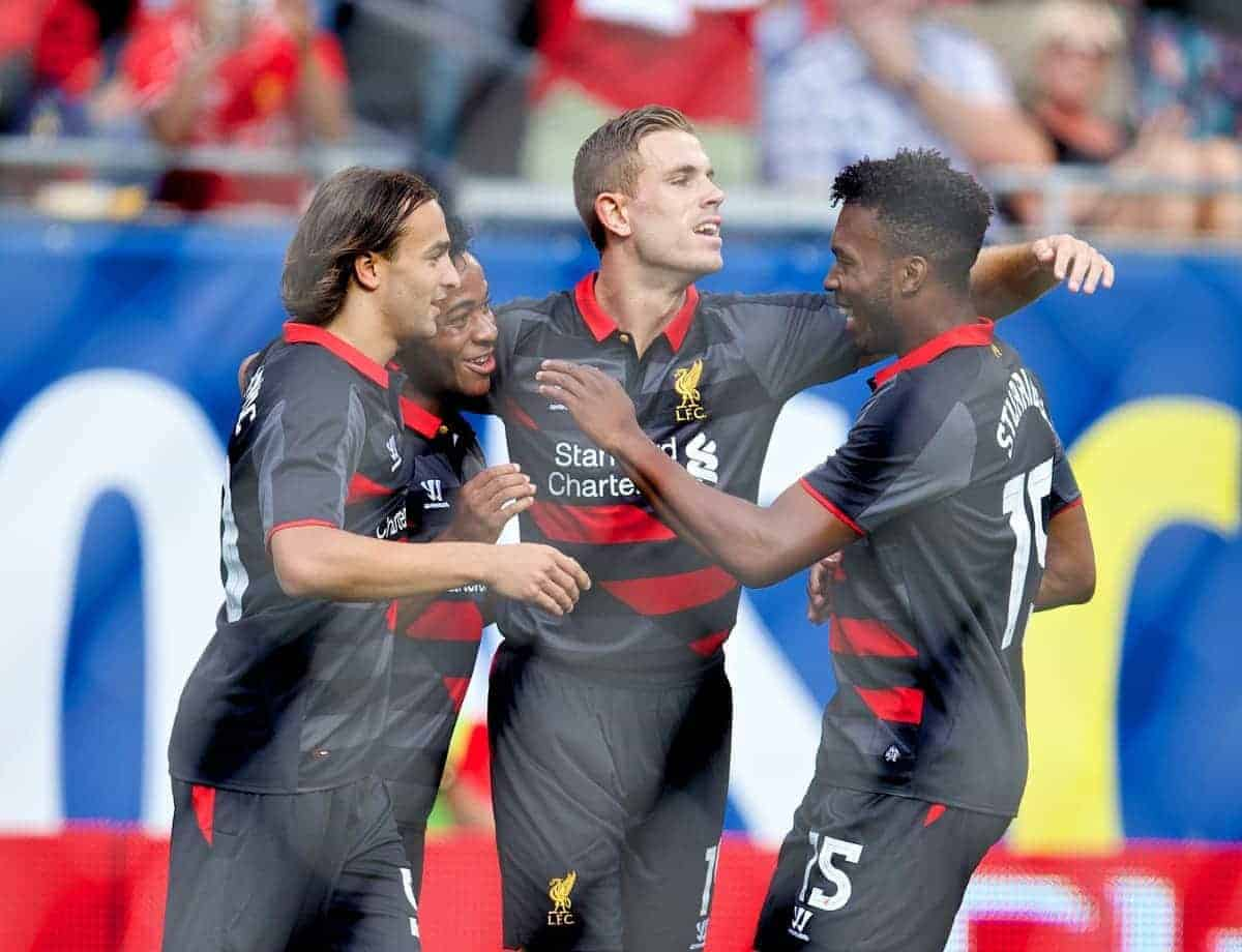 CHICAGO, USA - Sunday, July 27, 2014: Liverpool's Raheem Sterling celebrates scoring the first goal against Olympiacos2 with team-mates Lazar Markovic, Jordan Henderson and Daniel Sturridge during the International Champions Cup Group B match at the Soldier Field Stadium on day seven of the club's USA Tour. (Pic by David Rawcliffe/Propaganda)