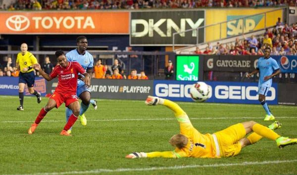 NEW YORK, USA - Wednesday, July 30, 2014: Liverpool's Raheem Sterling scores the second goal against Manchester City during the International Champions Cup Group B match at the Yankee Stadium on day ten of the club's USA Tour. (Pic by David Rawcliffe/Propaganda)