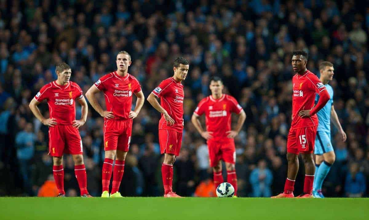 MANCHESTER, ENGLAND - Monday, August 25, 2014: Liverpool's captain Steven Gerrard, Jordan Henderson, Philippe Coutinho Correia and Daniel Sturridge look dejected as Manchester City score the opening goal during the Premier League match at the City of Manchester Stadium. (Pic by David Rawcliffe/Propaganda)