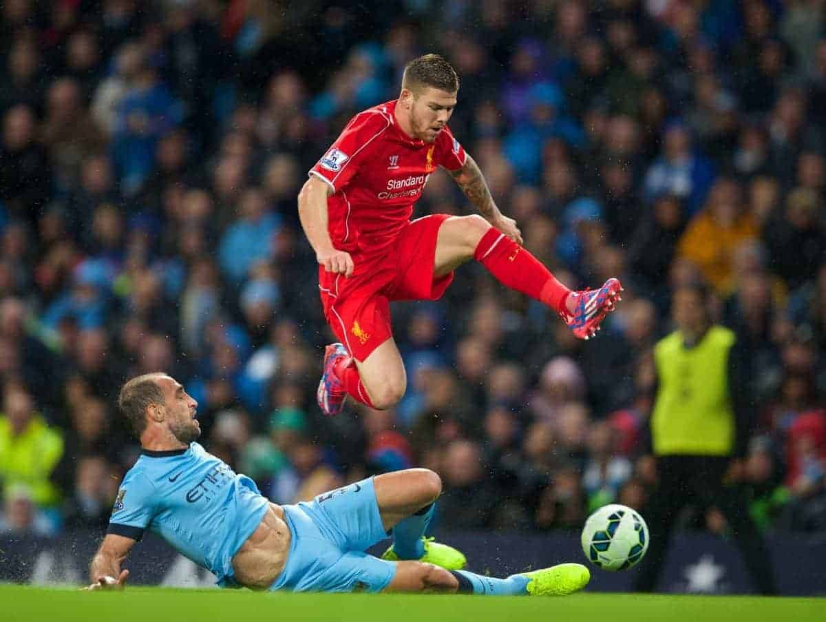 MANCHESTER, ENGLAND - Monday, August 25, 2014: Liverpool's Javier Manquillo in action against Manchester City's Pablo Zabaleta during the Premier League match at the City of Manchester Stadium. (Pic by David Rawcliffe/Propaganda)