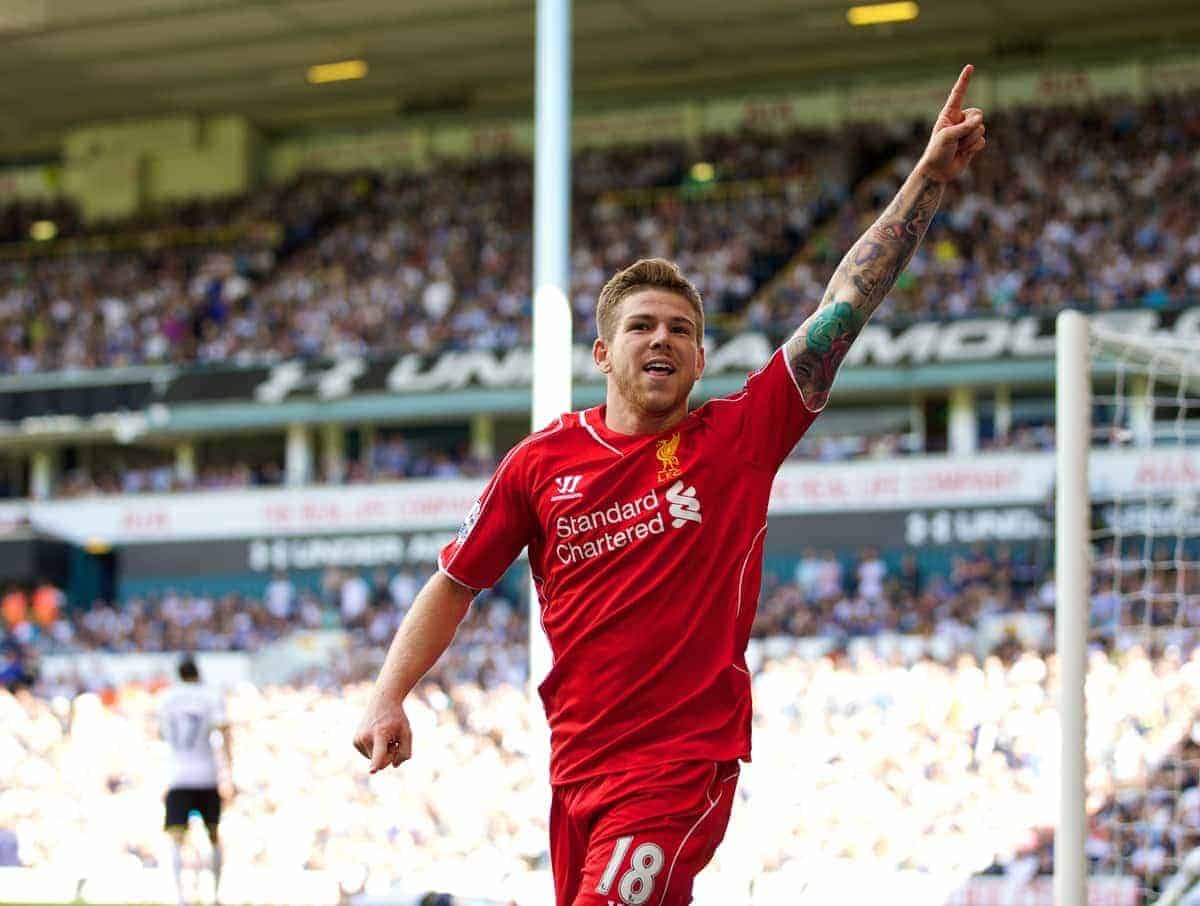 Liverpool's Alberto Moreno celebrates scoring the third goal against Tottenham Hotspur during the Premier League match at White Hart Lane. (Pic by David Rawcliffe/Propaganda)