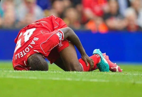 LIVERPOOL, ENGLAND - Saturday, September 13, 2014: Liverpool's Mario Balotelli goes down injured Aston Villa during the Premier League match at Anfield. (Pic by David Rawcliffe/Propaganda)