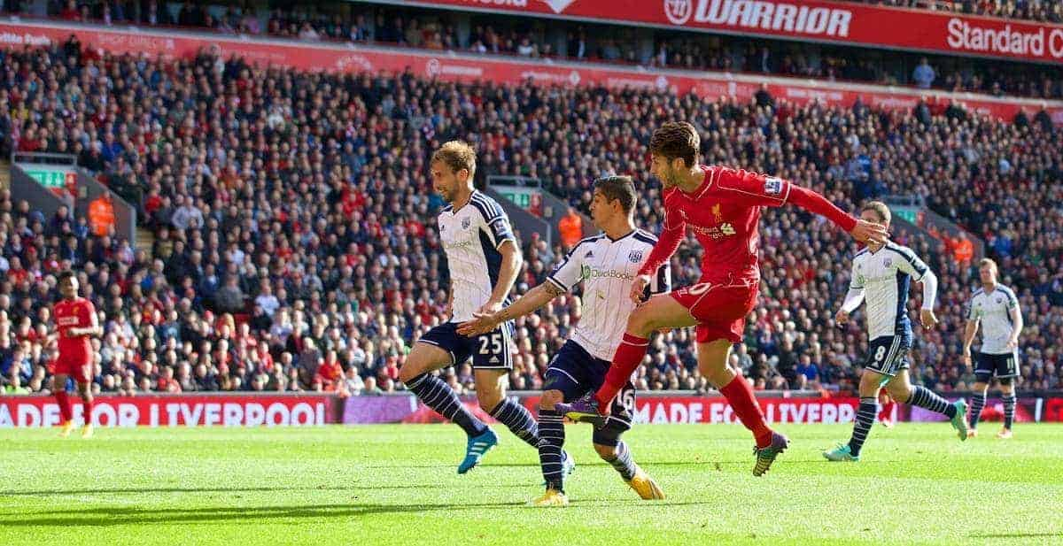 LIVERPOOL, ENGLAND - Saturday, October 4, 2014: Liverpool's Adam Lallana scores the first goal against West Bromwich Albion during the Premier League match at Anfield. (Pic by David Rawcliffe/Propaganda)